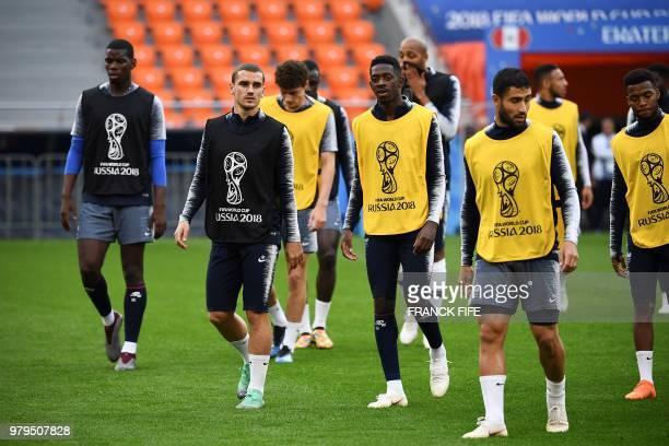 France's midfielder Paul Pogba France's forward Antoine Griezmann France's forward Ousmane Dembele and France's midfielder Nabil Fekir attend a...