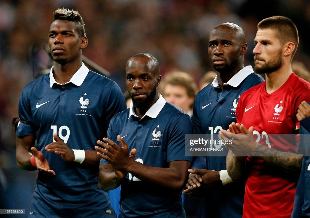 France's midfielder Paul Pogba, France's midfielder Lassana Diarra, France's defender Eliaquim Mangala and France's goalkeeper Benoit Costil applaud before the start of the friendly football match between England and France at Wembley Stadium in west London on November 17, 2015.