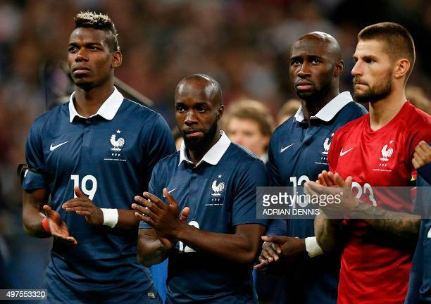 France's midfielder Paul Pogba France's midfielder Lassana Diarra France's defender Eliaquim Mangala and France's goalkeeper Benoit Costil applaud...