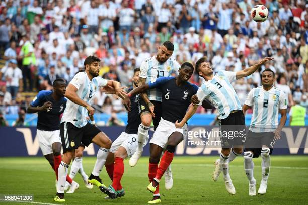 France's midfielder Paul Pogba heads the ball with XXXXXXXXX during the Russia 2018 World Cup round of 16 football match between France and Argentina...