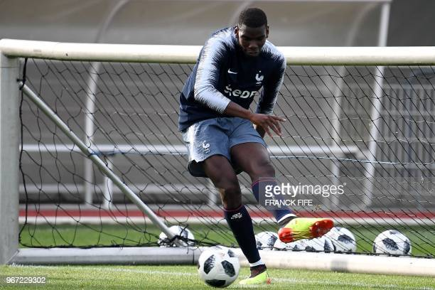 France's midfielder Paul Pogba plays the ball during a training session in ClairefontaineenYvelines on June 4 as part of the team's preparation for...