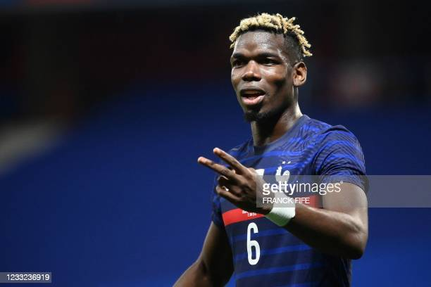 France's midfielder Paul Pogba reacts during the friendly football match between France and Wales at the Allianz Riviera Stadium in Nice, southern...