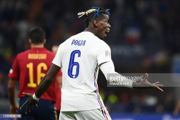 France's midfielder Paul Pogba reacts during the Nations League final football match between Spain and France at San Siro stadium in Milan, on...