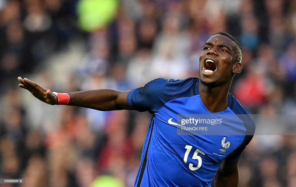 TOPSHOT - France's midfielder Paul Pogba reacts to a missed shot during the friendly football match between France and Cameroon, at the Beaujoire Stadium in Nantes, western France, on May 30, 2016. / AFP / FRANCK