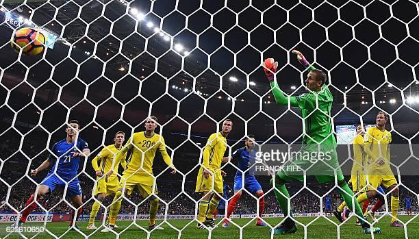 France's midfielder Paul Pogba scores a goal next to France's defender Raphael Varane in front of Sweden's goalkeeper Robin Olsen during the 2018...