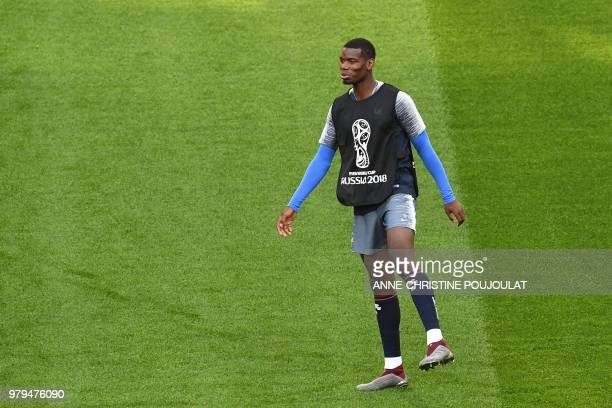 France's midfielder Paul Pogba takes part in a training session at the Ekaterinburg Arena in Ekaterinburg on June 20 2018 on the eve of the Russia...