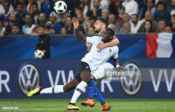 France's midfielder Paul Pogba vies for the ball with Italy's defender Danilo D'Ambrosio during the friendly football match between France and Italy...