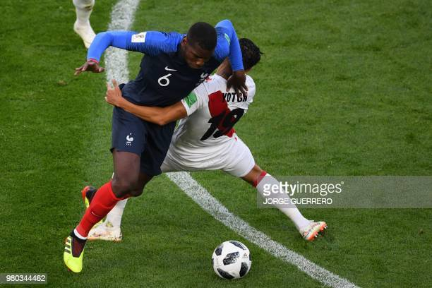 TOPSHOT France's midfielder Paul Pogba vies for the ball with Peru's midfielder Yoshimar Yotun during the Russia 2018 World Cup Group C football...