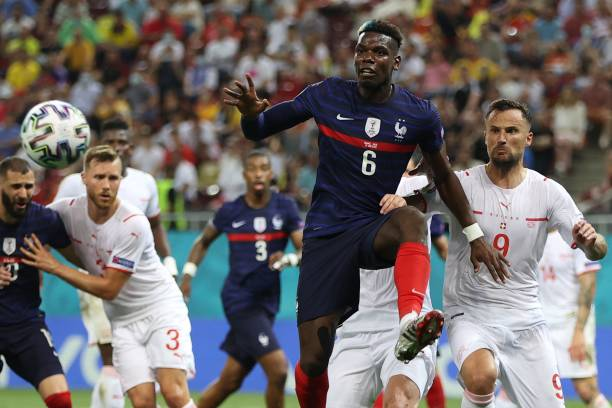 France's midfielder Paul Pogba vies for the ball with Switzerland's forward Haris Seferovic during the UEFA EURO 2020 round of 16 football match...
