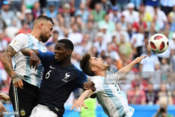 France's midfielder Paul Pogba vies with Argentina's defender Nicolas Otamendi and Argentina's defender Nicolas Tagliafico during the Russia 2018...