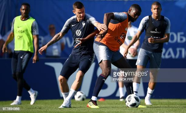 France's midfielder Paul Pogba vies with France's defender Lucas Hernandez during a training session at the Glebovets stadium in Istra west of Moscow...