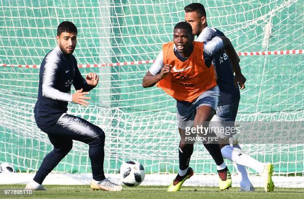 France's midfielder Paul Pogba vies with France's forward Nabil Fekir during a training session at the Glebovets stadium in Istra west of Moscow on...