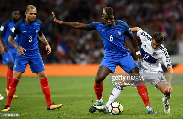 TOPSHOT France's midfielder Paul Pogba vies with Luxembourg's midfielder Danel Sinani during the FIFA World Cup 2018 qualifying football between...