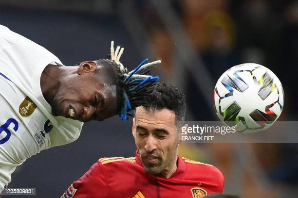 France's midfielder Paul Pogba vies with Spain's midfielder Sergio Busquets during the Nations League final football match between Spain and France...