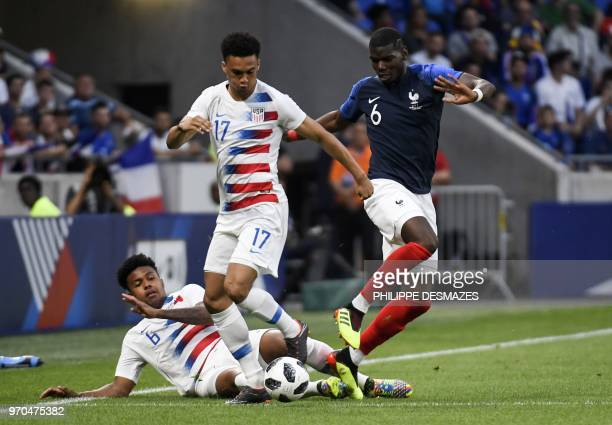 France's midfielder Paul Pogba vies with USA's defender Antonee Robinson and USA's midfielder Weston McKennie the friendly football match between...