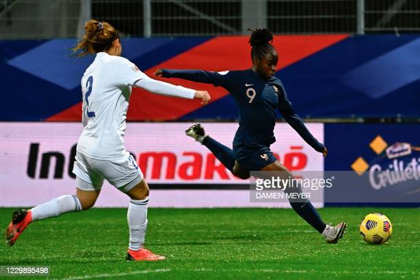 Frances midfielder Sandy Baltimore fights for the ball with Kazakhstans defender Alexandra Burova during the Women's UEFA Euro 2022 Group G qualifier...