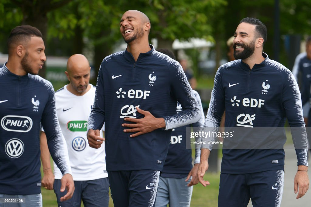 France's midfielder Steven Nzonzi (C) and Adil Rami (L) arrive a training session at the French national football team centre in Clairefontaine-en-Yvelines on May 25, 2018 in Clairefontaine, France. The French national football team begin their preparation for the upcoming FIFA 2018 World Cup in Russia.