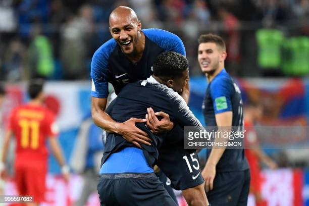 France's midfielder Steven N'Zonzi and France's defender Presnel Kimpembe celebrate at the end of the Russia 2018 World Cup semifinal football match...