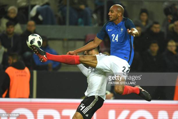 TOPSHOT France's midfielder Steven N'Zonzi and Germany's midfielder Emre vie for the ball during the international friendly football match Germany...