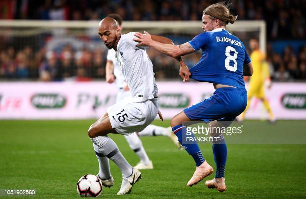 France's midfielder Steven N'zonzi vies with Iceland's midfielder Birkir Bjarnason during the friendly football match between France and Iceland at...