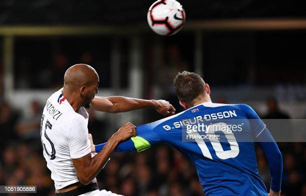 TOPSHOT France's midfielder Steven N'zonzi vies with Iceland's midfielder Gylfi Sigurdsson during the friendly football match between France and...