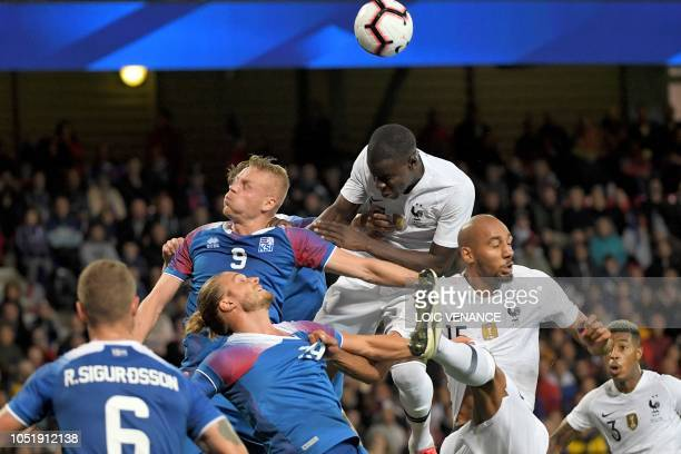 France's midfielder Tanguy Ndombele heads the ball during the friendly football match between France and Iceland at the Roudourou Stadium in Guingamp...