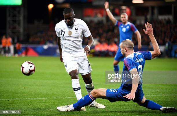 France's midfielder Tanguy Ndombele vies with Iceland's midfielder Jon Gudni Fjoluson during the friendly football match between France and Iceland...