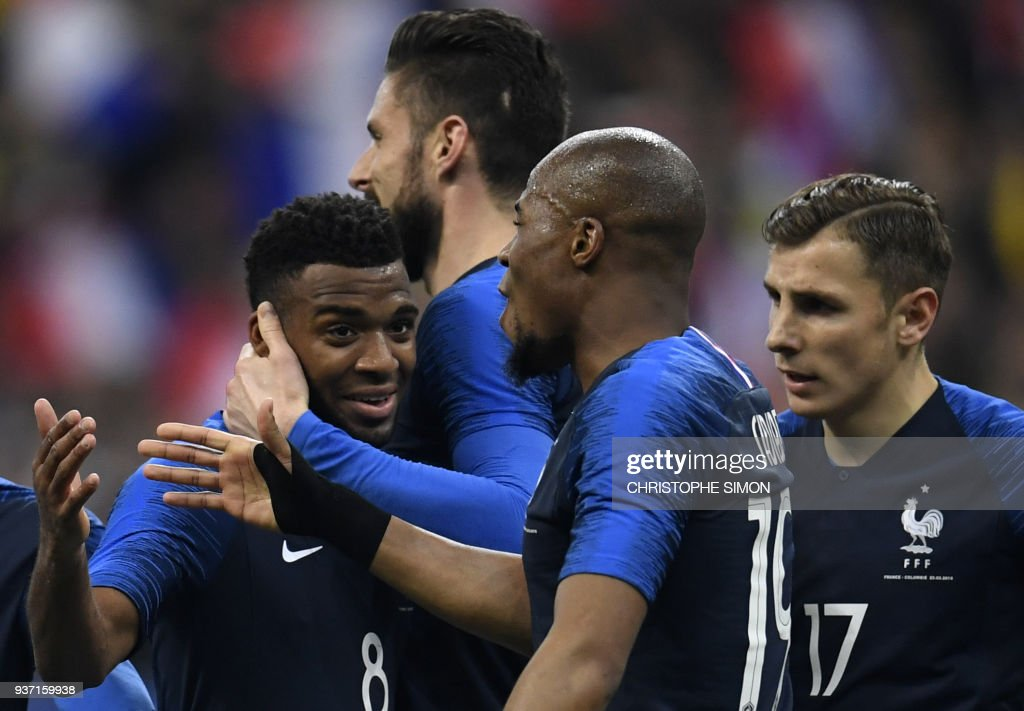 France's midfielder Thomas Lemar celebrates with teammates after scoring a goal during the friendly football match between France and Colombia at the Stade de France, in Saint-Denis, on the outskirts of Paris, on March 23, 2018. /