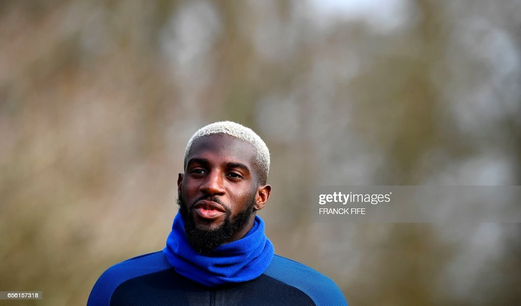 France's midfielder Tiemoue Bakayoko arrives for a training session in Clairefontaine, near Paris, on March 21, 2017, as part of the team's preparation for the upcoming World Cup 2018 qualifiers. FIFE