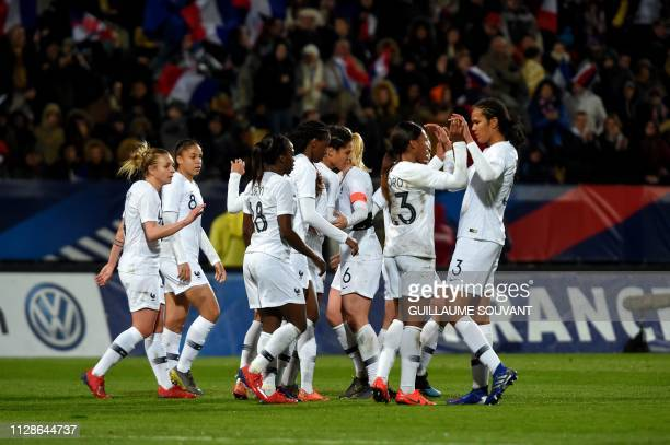France's midfielder Valerie Gauvin celebrates with teammates after a goal during the friendly football match France vs Uruguay at the Vallee du Cher...