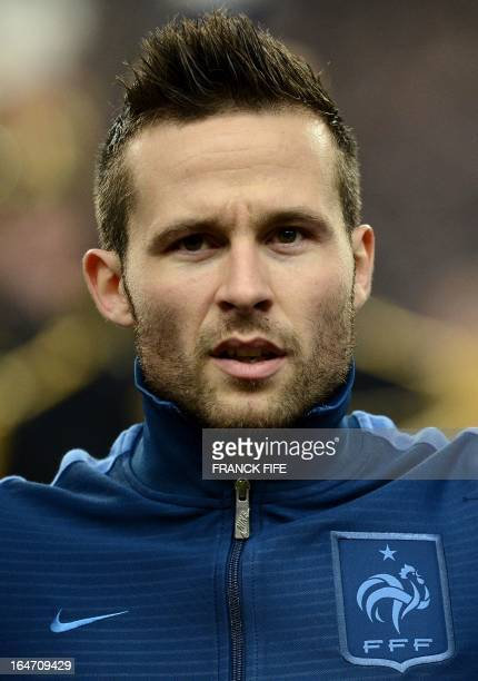 France's midfielder Yohan Cabaye listens to the national anthems before a World Cup 2014 qualifying football match between France and Spain on March...