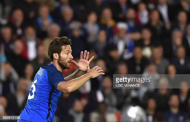 France's midfielder Yohan Cabaye reacts during the International friendly football match between France and Cameroon at the Beaujoire stadium in...