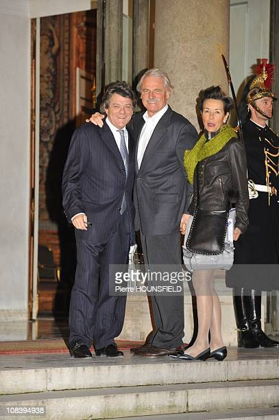 France's Minister for Ecology Energy and Sustainable Planning and Development JeanLouis Borloo poses with French photographer and ecology activist...
