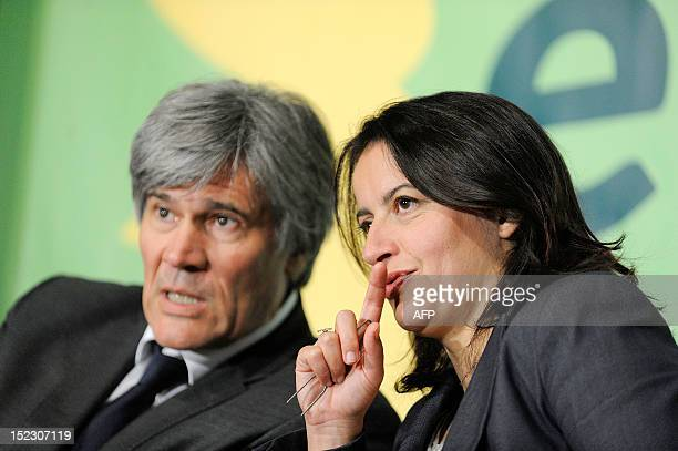 France's Minister for Equality of Territories and Housing, Cecile Duflot talks with France's Agriculture Minister Stephane Le Foll during the Europe...