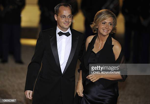 France's Minister for Higher Education and Research Valerie Pecresse and her husband Jerome Pecresse pose as they arrive prior to a state dinner with...