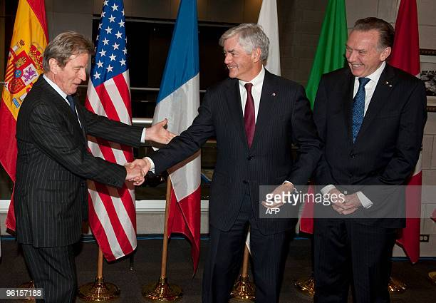 France's minister of foreign and european affairs Bernard Kouchner shakes hands with Canada's minister of foreign affairs Lawrence Cannon and Peter...