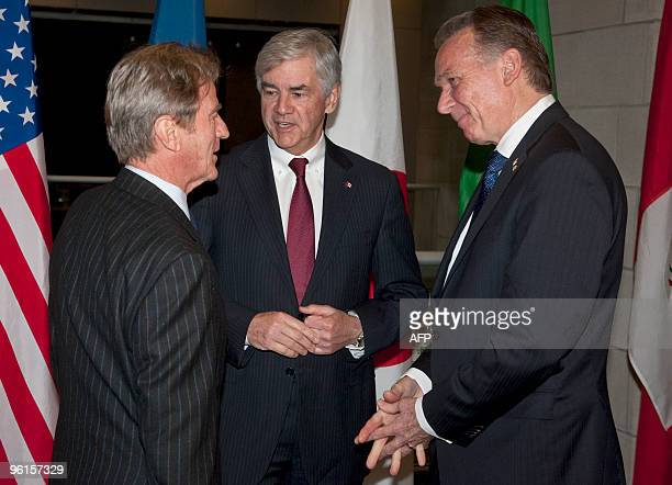 France's minister of foreign and european affairs Bernard Kouchner speaks with Canada's minister of foreign affairs Lawrence Cannon and Peter Kent...