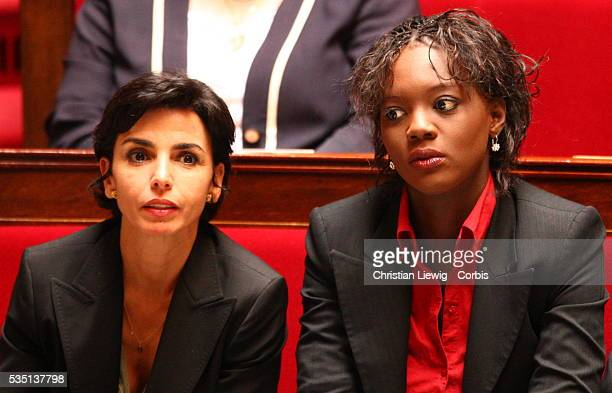 France's Minister of Justice Rachida Dati and Junior Minister for Human Rights Rama Yade listen to the speech delivered by French Prime Minister...