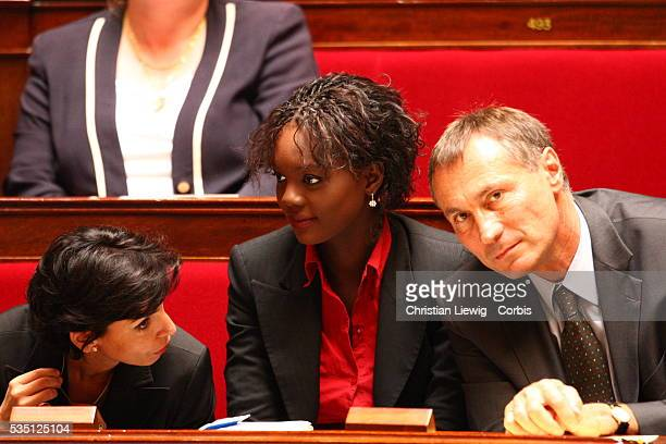France's Minister of Justice Rachida Dati, Junior Minister for Human Rights Rama Yade and Senator Jean Marie Bocquel whisper during the speech...