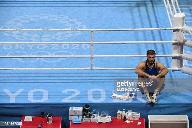 France's Mourad Aliev waits outside the ring after losing by disqualification against Britain's Frazer Clarke during their men's super heavy...
