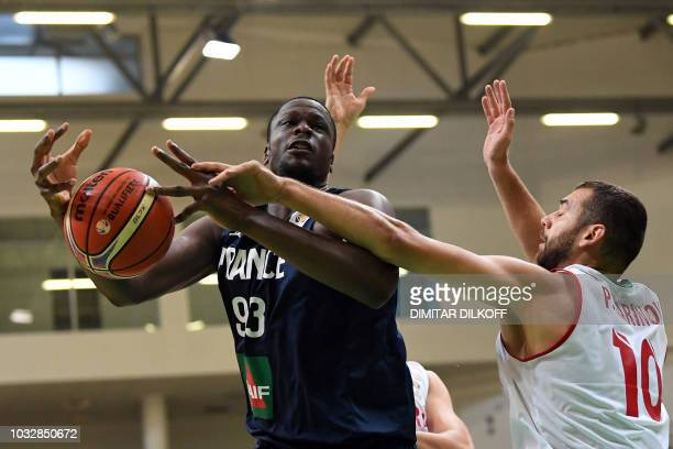 France's Moustapha Fall fights for the ball with Bulgaria's Pavel Marinov during the 2019 FIBA European qualifying basketball match between Bulgaria...