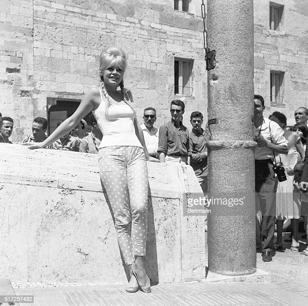 France's movie star Brigitte Bardot wearing tight Capristyle pants jeans provocatively against wall during current visit to Italy She seems to have...