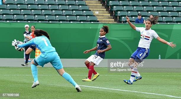 France's Mylaine Terrieu shoots and scores in action against Paraguay at the FIFA U-20 Girls World Cup at Commonwealth Stadium in Edmonton, Alberta,...