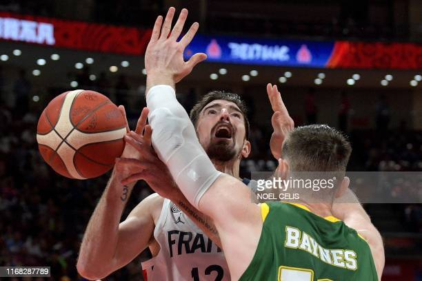 TOPSHOT France's Nando De Colo and Australia's Aron Baynes fight for the ball during the Basketball World Cup third place game between France and...