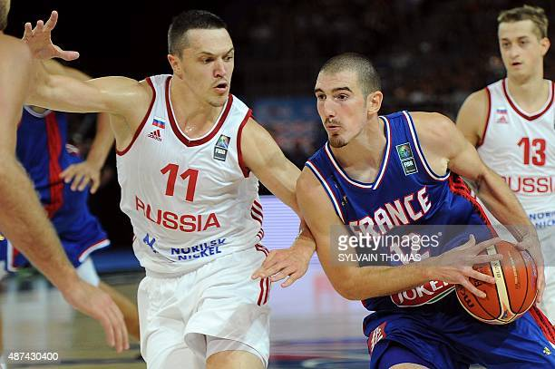 France's Nando De Colo challenges Russia's Semen Antonov during the 2015 EuroBasket group A basketball match between France and Russia in Montpellier...