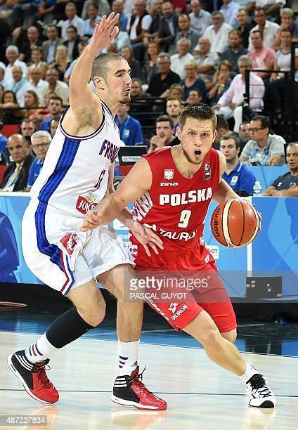 France's Nando De Colo defends against Poland's Mateusz Ponitka during the group A qualification basketball match between France and Poland at the...