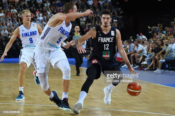 France's Nando De Colo fights for the ball with Finland's Alex Murphy during the 2019 FIBA Basketball World Championship European qualifying group...