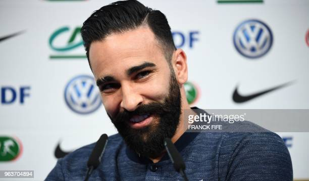 France's national football team defender Adil Rami attends a press conference at the team's training camp in ClairefontaineenYvelines on May 30 as...