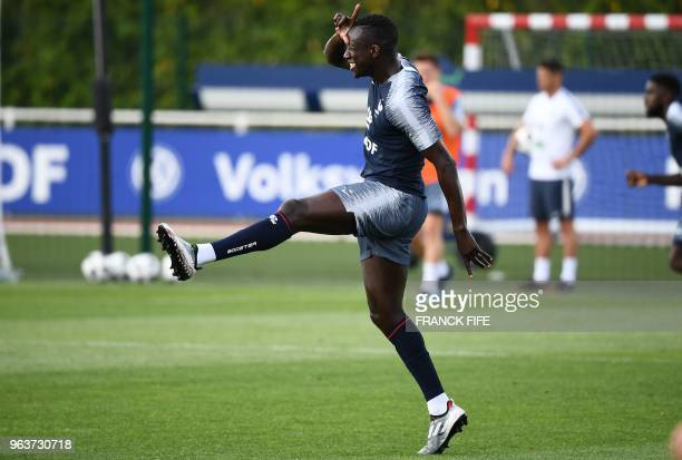 France's national football team defender Benjamin Mendy celebrates after scoring a goal during a training session at the team's training cam in...