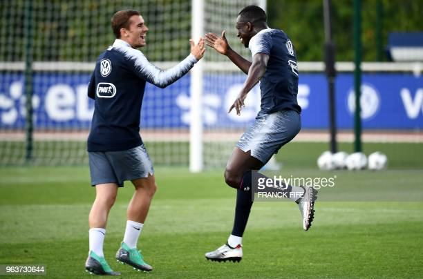 France's national football team defender Benjamin Mendy jokes with forward Antoine Griezmann during a training session at the team's training cam in...